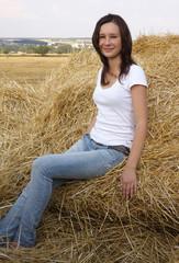 Beautiful young girl on hayloft