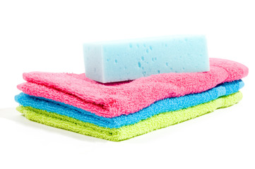 Multicolour towels stacked and body sponge