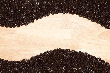 Dark Roasted Coffee Beans on Wood Background