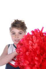cute young cheerleader holding large red pompom