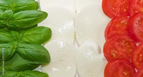 Italian flag made of basil mozzarella and tomato