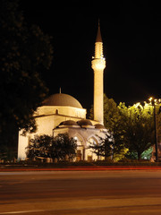 Mosque, crescent and star, traffic and lights at night