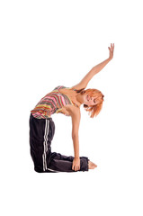 Red haired girl performing fitness exercises