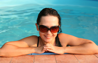 Young lady in the swimming pool