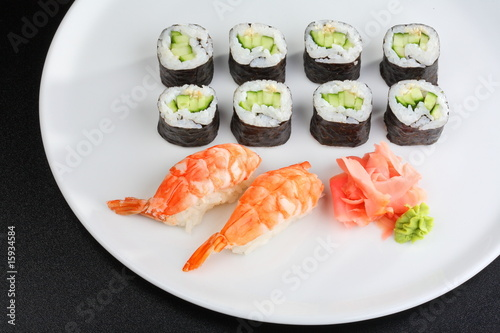 Japanese sushi set with shrimps and cucumber and avacado rolls