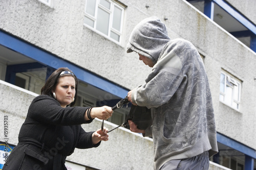 Man Mugging Woman In Street