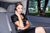 Portrait of beautiful business woman inside the limo car - Fine Art prints