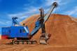 Heavy electric excavator in sandpit