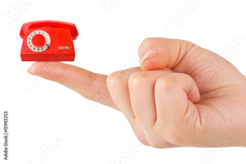 Hand and small telephone