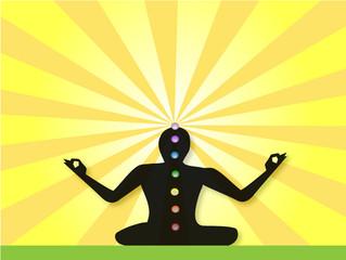 Yogi Meditating facing a sunburst