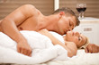 lovers kissing in bedroom