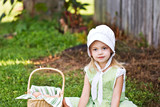 Little Amish girl gathering eggs