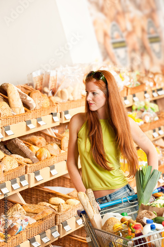 Grocery store: Red hair woman with shopping cart
