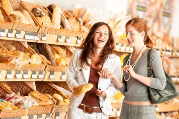 Grocery store: Two women choosing bread