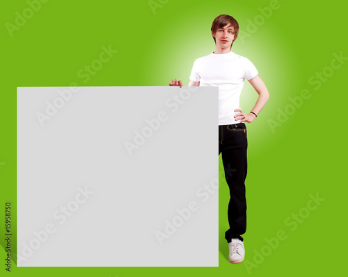 beautiful young man holds a sheet of paper
