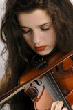Young woman playing violin, close-up