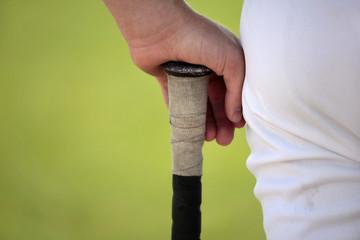 Player holding baseball bat