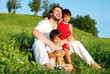 Young father in white with children on beautiful meadow