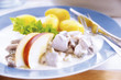 Matjes herring on plate with side dishes