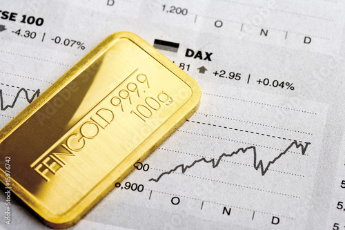Gold bar and financial newspaper