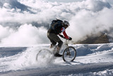 Spain, Sierra Nevada, mountainbiking across snow