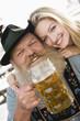 Deutschland, Bayern, Senior Mann und Frau jung, Lächeln, Portrait, close-up