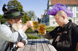 Germany, Bavaria, Upper Bavaria, Man with mohawk hairstyle and Bavarian man holding beer stein glasses