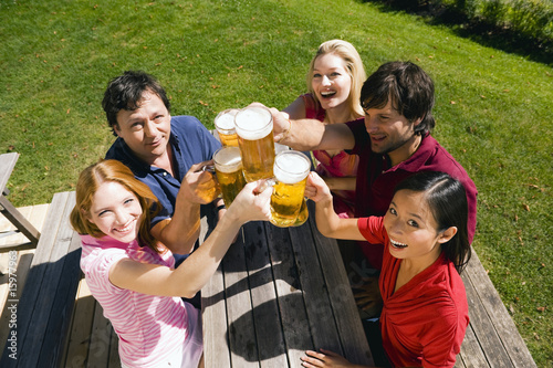 Germany, Bavaria, Upper Bavaria, Cheerful people toasting each other in beer garden, elevated view