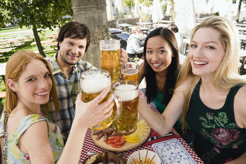 Germany, Bavaria, Upper Bavaria, Young people in beer garden, smiling