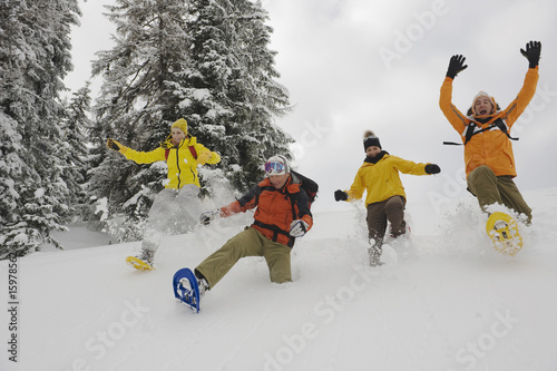 Italy, South Tyrol, People with snowshoes fooling about