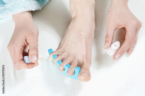 Woman painting her toenails, elevated view