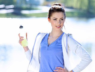 young fitness woman drinking water
