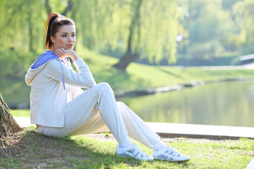 young fitness woman in park