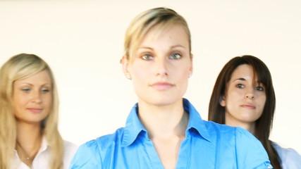 Three beautiful businesswomen smiling at the camera
