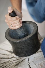 Woman using mortar and pestle