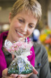 Woman holding a bouquet of flowers and smiling