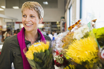 Woman smiling in a florist shop