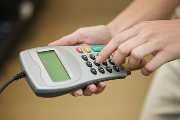 Woman using credit card reader in a boutique