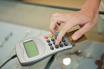 Customer using credit card reader in a boutique