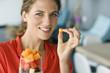 Portrait of a woman holding fruit salad
