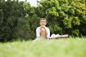 Boy sitting in a park