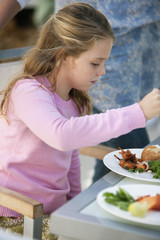 Girl having breakfast at a dining table