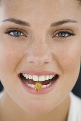 Portrait of a woman taking an Omega-3 capsule