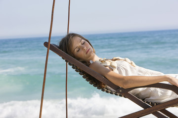Woman resting in a deck chair