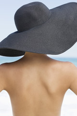 Rear view of a woman wearing hat on the beach