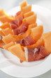 Slices of muskmelon wrapped in ham