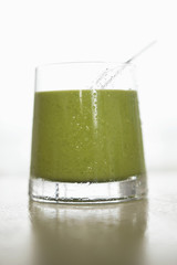 Close-up of a glass of green sauce