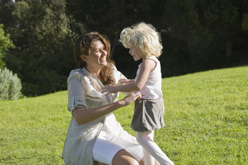 Woman playing with her daughter