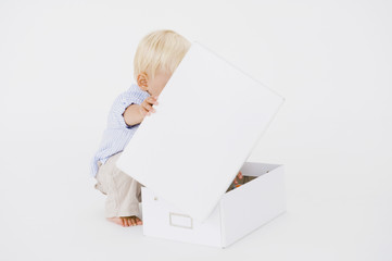 Baby boy opening a box