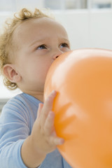 Baby boy playing with a balloon
